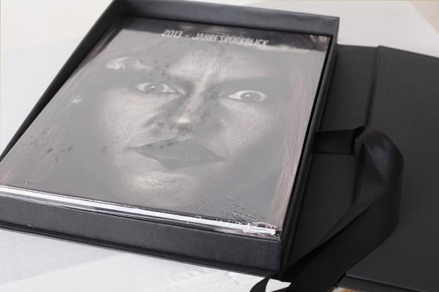 Das eingeschweißte Fotobuch und die Premium Präsentationsbox